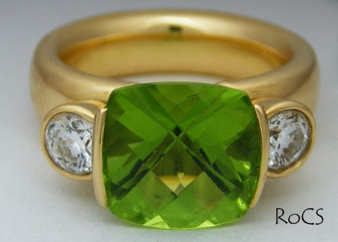 Peridot and diamond ring in 18ct gold image